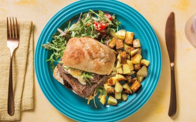 Steak Sandwich with Fried Potatoes with a Mustardy Rocket and Tomato Salad